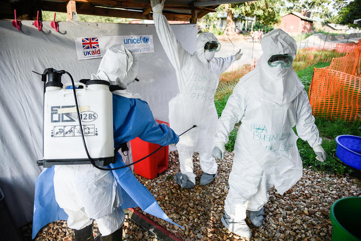 Medical staff of the Ebola Treatment Unit (ETU) get ready to work in their Personal Protective Equipment (PPE) during their weekly rehearsal at the Bwera General Hospital in Bwera bordering with DRC, western Uganda, on December 12, 2018.