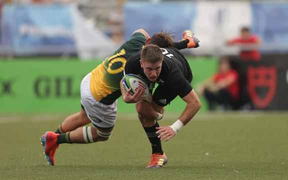 Fergus Burke of New Zealand is tackled by James Mollentze of South Africa during the World Rugby U20 Championship match.