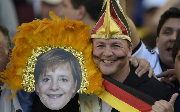 Germany fans, one wearing a mask of Chancellor Angela Merkel, at Maracana Stadium.