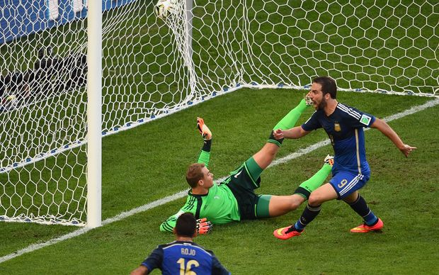 Argentina forward Gonzalo Higuain (right) shoots and scores a disallowed goal in the first half.