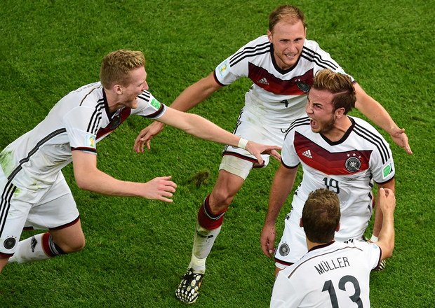 Germany's forward Mario Goetze (centre) celebrates with Andre Schuerrle, Benedikt Hoewedes and Thomas Mueller after the goal.