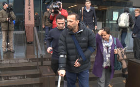 Mosque attack families exit court after the man charged pleaded not guilty to all charges.