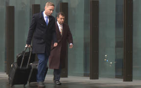Lawyers for the accused Christchurch mosque attacker, Shane Tait Jonathan Hudson, arrive at court.