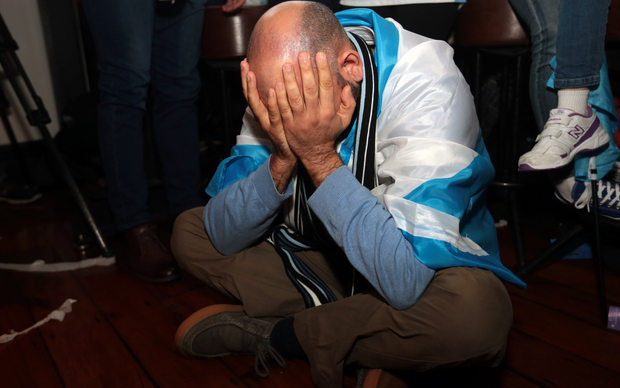 Despairing Argentina supporters watched the match slip away.