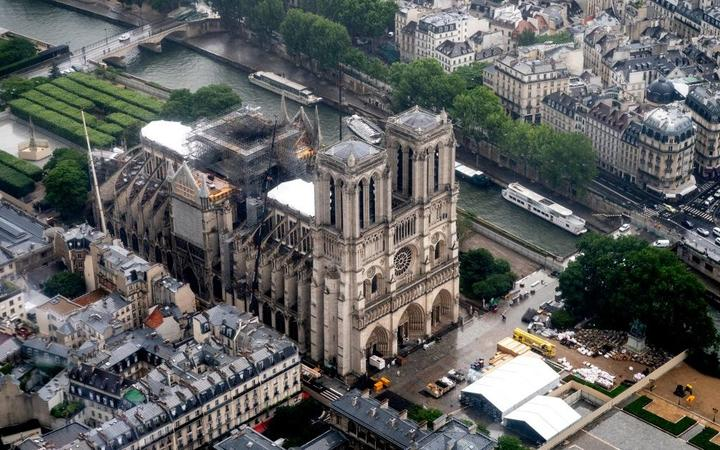 This aerial picture taken on June 12, 2019 in the French capital Paris shows the Notre Dame de Paris cathedral under repair after it was badly damaged by a huge fire on April 15.