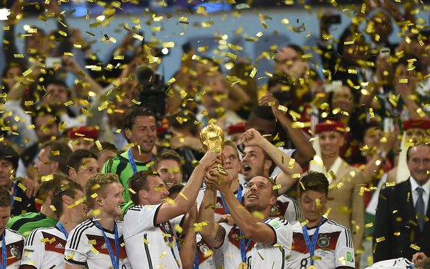 German players with the World Cup trophy snatched from Argentina in an extra-time win.