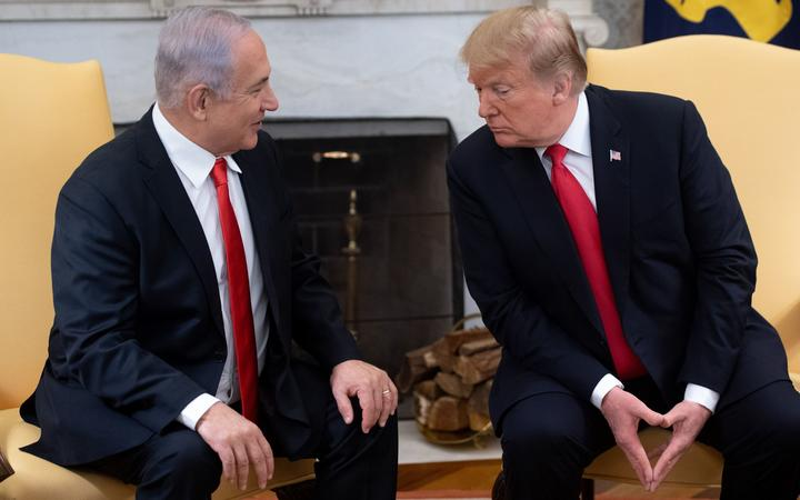 Israeli Prime Minister Benjamin Netanyahu and US President Donald Trump in the Oval Office at the White House in Washington, DC, March 25, 2019.
