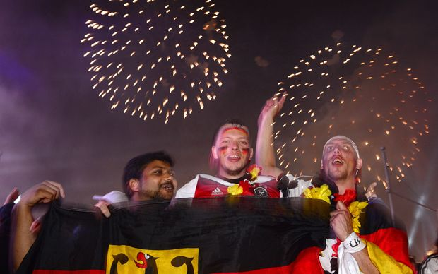Fans celebrate as fireworks were let off near the Brandenburg Gate in Berlin.