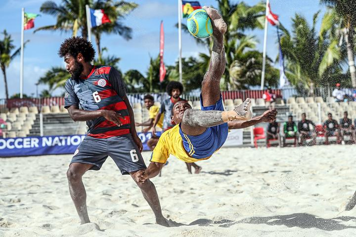 Solomon Islands James Naka does a bicycle kick during their opening match against New Caledonia at the OFC Beach Soccer Nations Cup 2019.