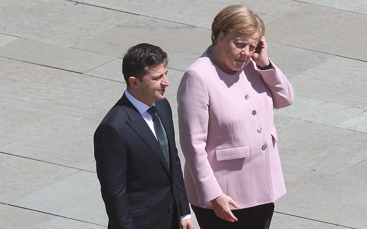 Germany`s Angela Merkel `fine` after seen shaking in...