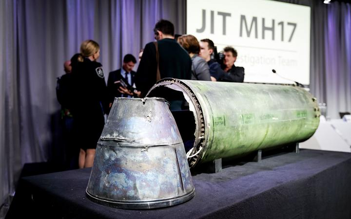 A part of the Buk Telar rocket that was fired on the MH17 flight is displayed on a table during the press conference of the Joint Investigation Team (JIT), in Bunnik on May 24, 2018.