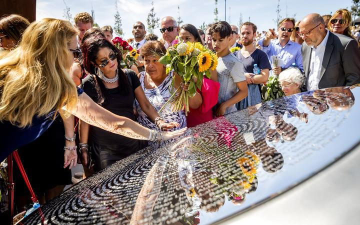 Relatives attend the unveiling of the National Monument for the MH17 victims in Vijfhuizen, the Netherlands  on July 17, 2017.