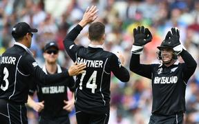 Mitchell Santner and wicketkeeper Tom Latham celebrate a wicket.