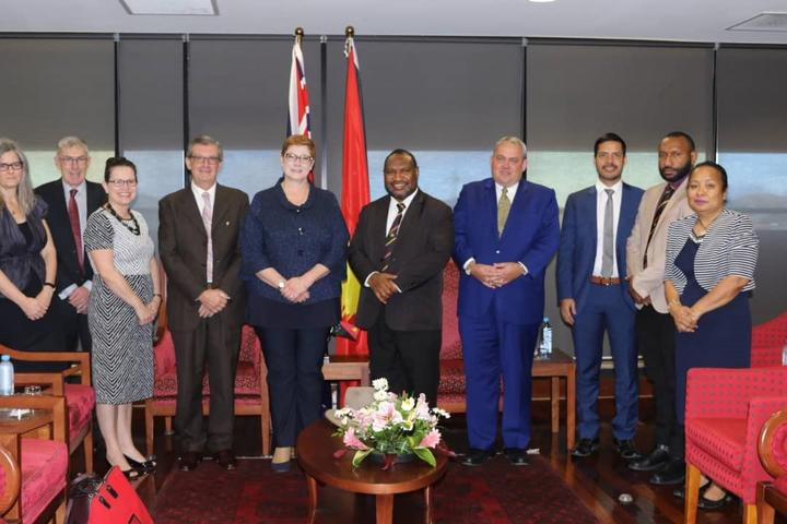 Australia's Defence Minister Marise Payne (fifth from left) meets PNG Prime Minister James Marape (next to Ms Payne) and members of his government.