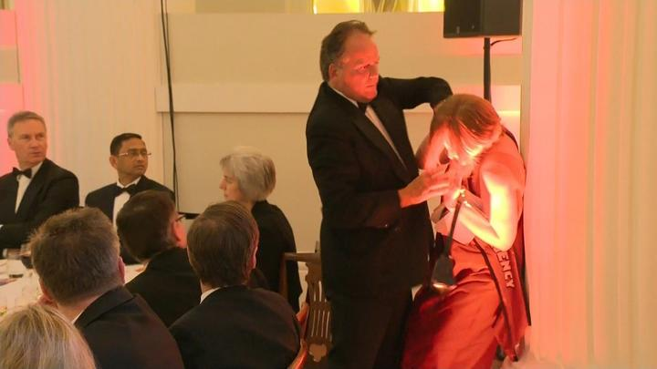 A still image taken from UK Pool video footage on June 21, 2019 shows Conservative MP Mark Field tackling a Greenpeace climate protester at a dinner at Mansion House in the City of London on June 21, 2019.
