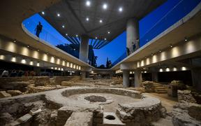 People visit a new section housing the remains of an ancient Athens neighbourhood beneath the Acropolis museum in Athens, on its opening day on June 21, 2019, marking the museum's 10-year-anniversary.