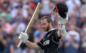 New Zealand's captain Kane Williamson celebrates after scoring a century during the 2019 Cricket World Cup group stage match between West Indies and New Zealand at Old Trafford in Manchester.