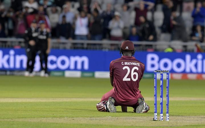 West Indies' Carlos Brathwaite reacts after losing his wicket having fallen short in the run-chase during the 2019 Cricket World Cup group stage match between West Indies and New Zealand at Old Trafford in Manchester.