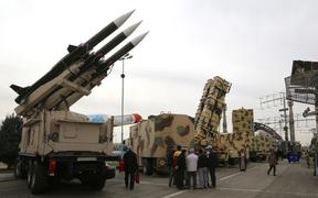 Iranians visit a weaponry and military equipment exhibition in the capital Tehran in February, organised to mark the 40th anniversary of the Iranian revolution.