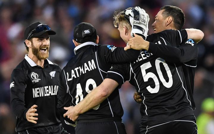 Kane Williamson and the Black Caps celebrate their win over the West Indies.