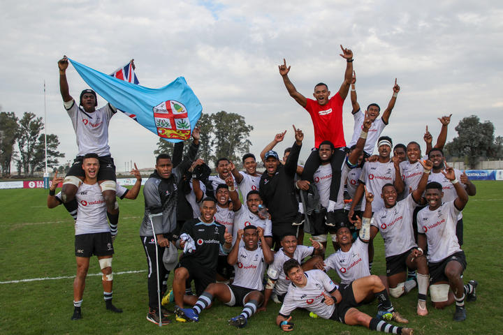 Fiji celebrate beating Scotland to retain their place in the World Rugby Under 20 Championship.