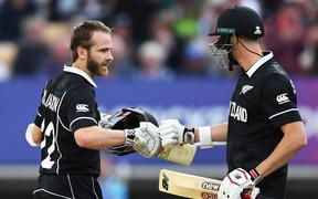 Kane Williamson and Mitchell Santner at the end of the match.