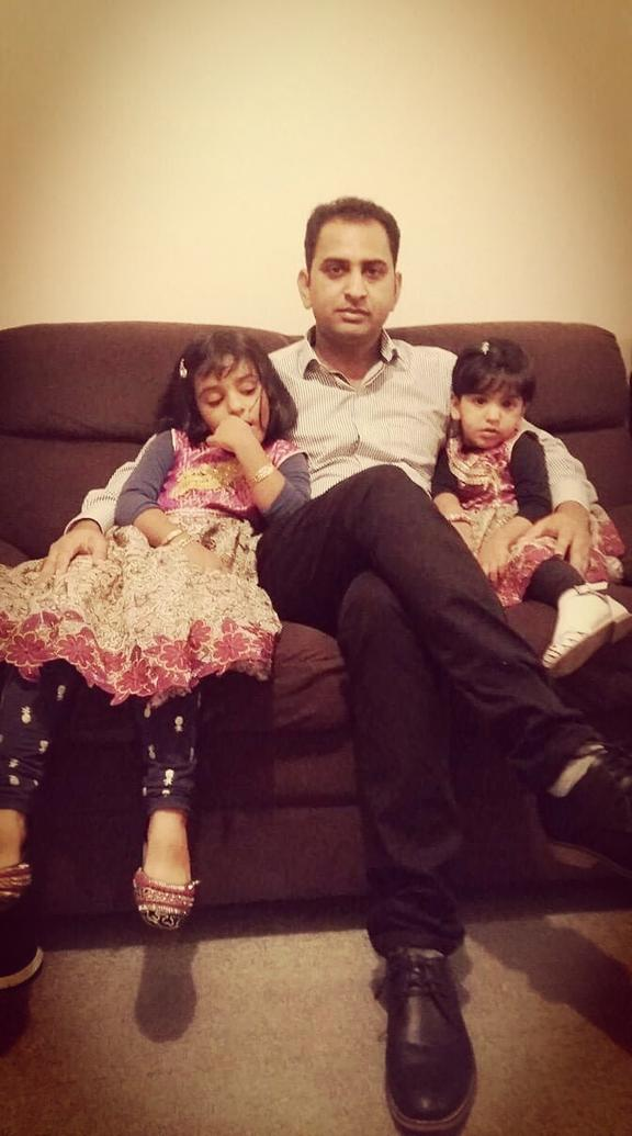 Muhammad Suhail Shahid and his two daughters.