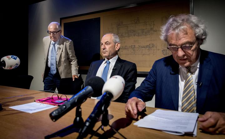 Former Ajax football club physiotherapist and holocaust victim Salo Muller (L), chairman of a commission that proposed reparations Job Cohen (C) and president director of the Dutch national rail company NS Roger van Boxtel (R) in Utrecht on June 26, 2019.