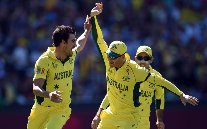 Australian bowler Mitchell Starc and captain Michael Clarke celebrate the wicket of New Zealand captain Brendon McCullum during the Cricket World Cup Final in 2015 at the MCG.