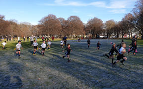 Children brave the cold in Hagley Park after coldest night so far this winter in Christchurch.