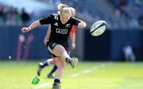 Black Ferns' Kendra Cocksedge kicks a conversion.