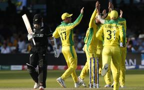 Australia's Mitchell Starc (R) celebrates with teammates after taking the wicket of New Zealand's captain Kane Williamson (L) for 40 during the 2019 Cricket World Cup group stage match between New Zealand and Australia at Lord's Cricket Ground in London