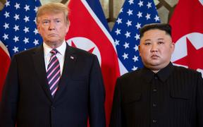 (FILES) In this file photo taken on February 27, 2019 US President Donald Trump (L) and North Korea's leader Kim Jong Un pose before a meeting at the Sofitel Legend Metropole hotel in Hanoi. -