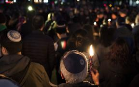 Members and supporters of the Jewish community come together for a candlelight vigil, in remembrance of those who died earlier in the day during a shooting at the Tree of Life Synagogue in the Squirrel Hill neighborhood of Pittsburgh,