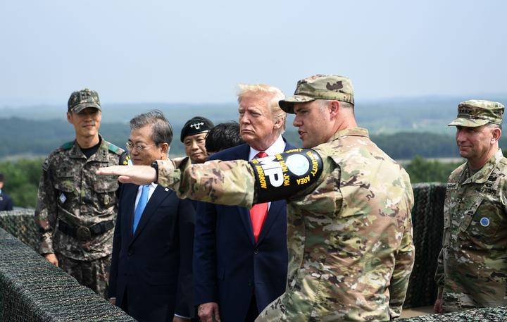 US President Donald Trump (3rd R) and South Korean President Moon Jae-in (2nd L) visit an observation post in the Joint Security Area (JSA) at Panmunjom in the Demilitarized Zone (DMZ) separating North and South Korea on June 30, 2019.