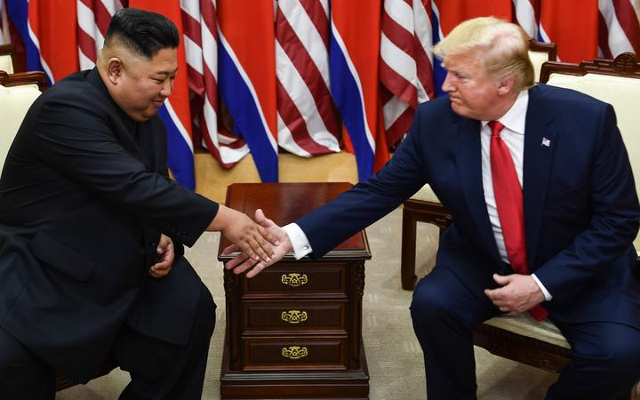 North Korea's leader Kim Jong Un (L) and US President Donald Trump shake hands during a meeting on the south side of the Military Demarcation Line that divides North and South Korea, in the Joint Security Area (JSA) of Panmunjom in the Demilitarized zone (DMZ) on June 30, 2019.