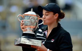 Ashley Barty celebrates with French Open trophy.