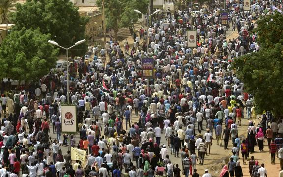 Sudanese protesters march in a mass demonstration against the country's ruling generals in the capital Khartoum's twin city of Omdurman.