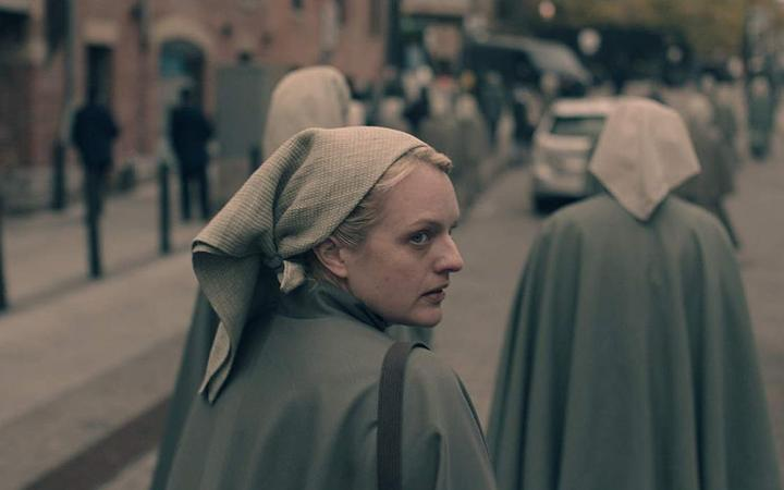 Elisabeth Moss in the third season of The Handmaid's Tale, after burying a body in the backyard.