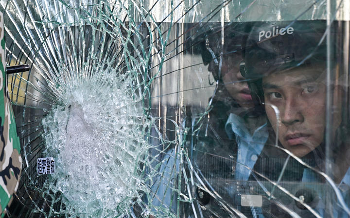 Chinese media calls for 'zero tolerance' after violent Hong Kong protests