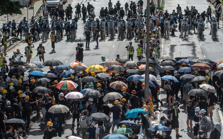 Protesters and police face-off at Harcourt Road.