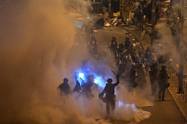 Police fire tear gas at protesters near the government headquarters in Hong Kong on 2 July 2019.
