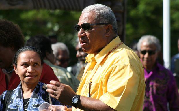West Papuan activist Paula Makabori looks at Fiji leader Frank Bainimarama.