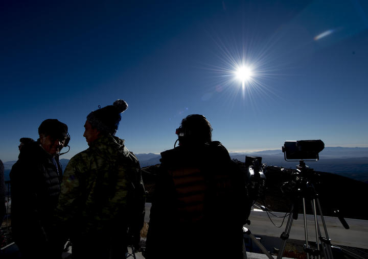People watch a solar eclipse at La Silla European Southern Observatory (ESO) in La Higuera, Coquimbo Region, Chile.