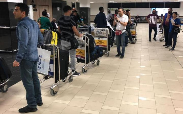 Refugees at Port Moresby airport 26 June, 2019.