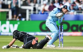 Ross Taylor is run out by Jos Buttler.