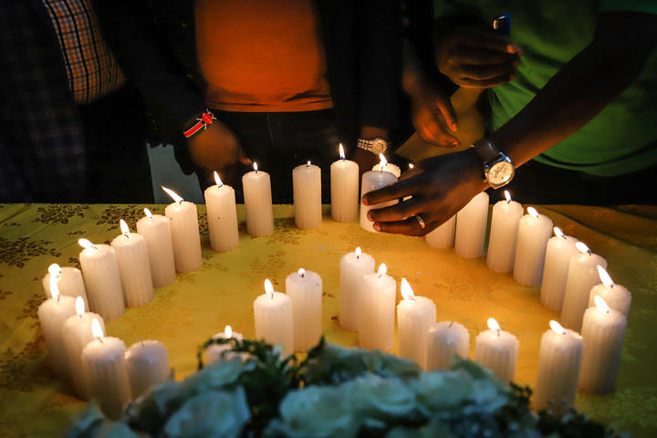 Relatives of victims, who perished among the 157 passengers and crew onboard the Ethiopian Airlines operated Boeing 737 MAX 8 aircraft, light candles during a memorial service at the Kenyan Embassy in Addis Ababa, on March 16, 2019.