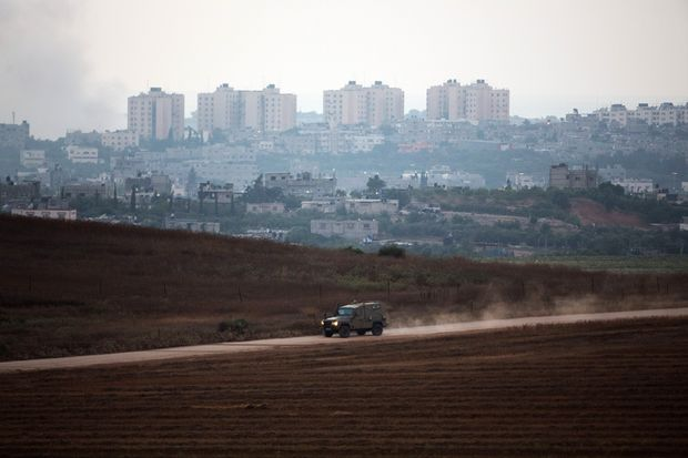 A picture taken from the Israeli border with the Gaza Strip shows an Israeli army vehicle on patrol.