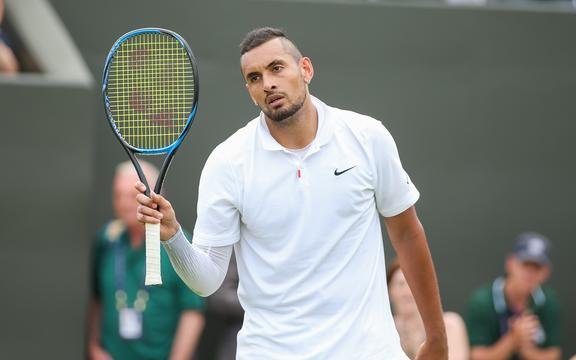 Nick Kyrgios of Australia reacts to the fans at Wimbledon.