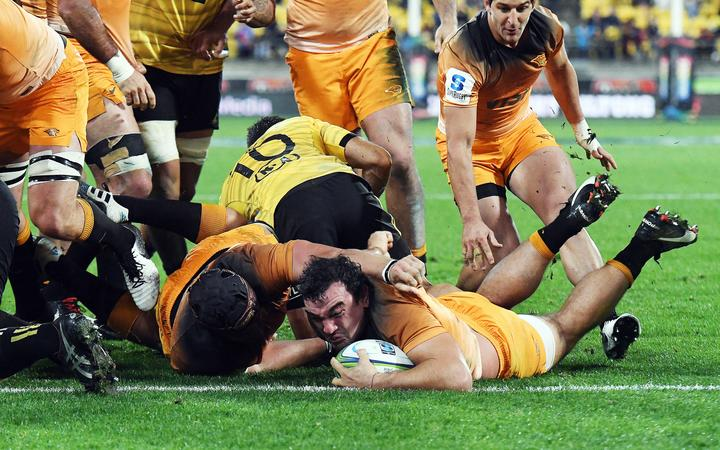 Jaguares Agustin Creevy scores a try against the Hurricanes.